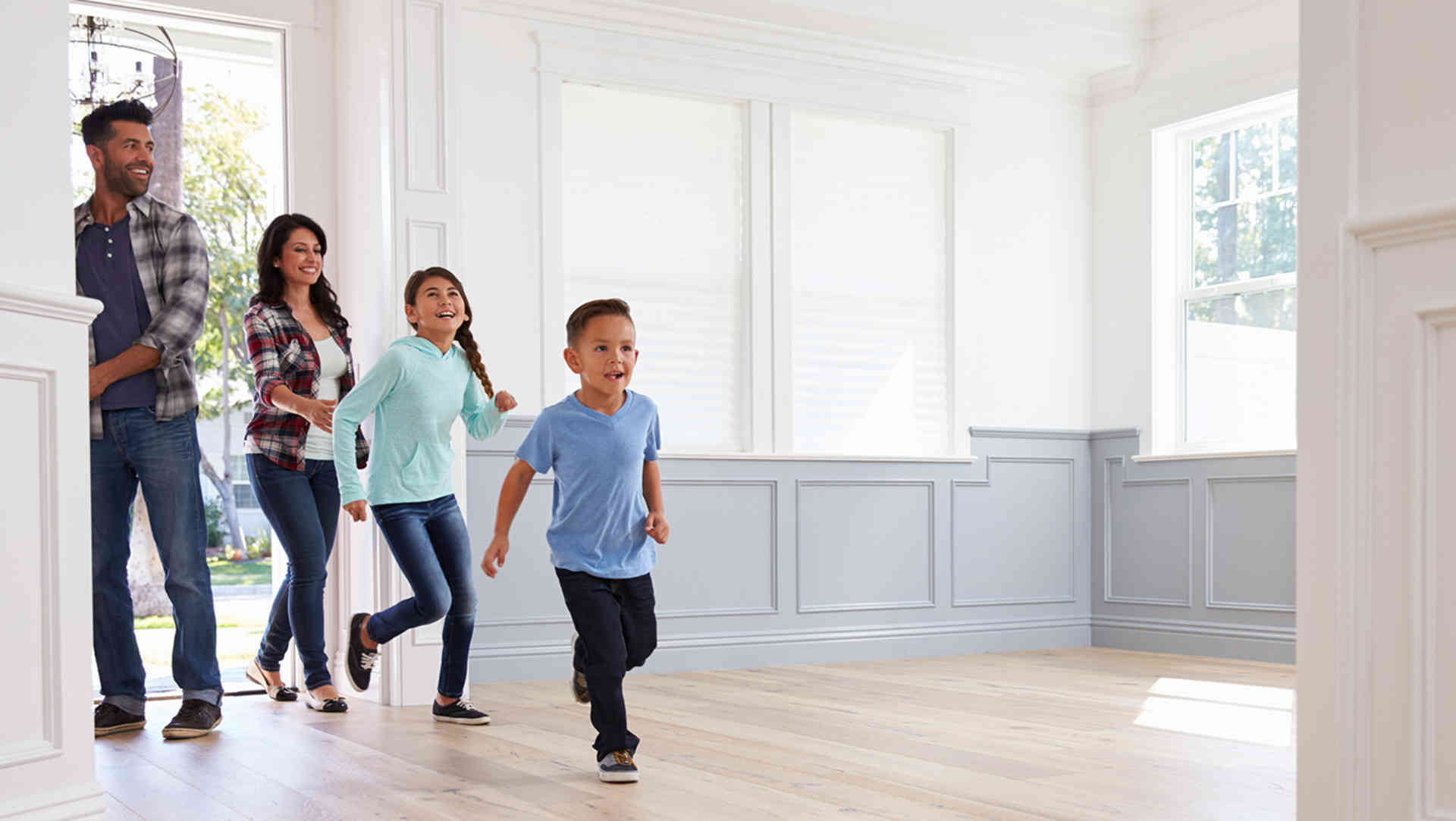 Family Entering Home Image